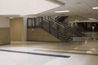 View from the bottom floor of central hallway where a  new staircase now stands where lockers once stood