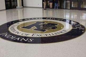 A new Keller High School seal greets visitors on the floor of the new secure entry vestibule.