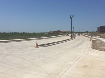 Newly extended Thompson Road looking west toward the I-35W service road